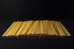Pastas en un fondo negro Imágenes de archivo libres de regalías