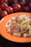Pastas italianas con el prosciutto Imagenes de archivo