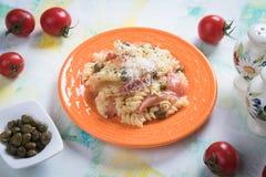 Pastas italianas con el prosciutto Imagen de archivo libre de regalías