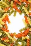 Pastas italianas crudas - tres espirales de los colores Imagenes de archivo