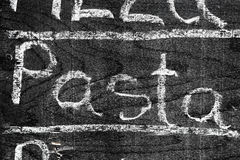 PASTAS manuscritas de la inscripción con tiza foto de archivo