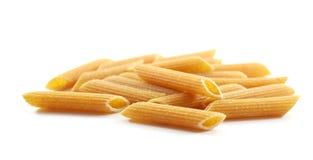 Pastas orgánicas del penne del trigo integral Imágenes de archivo libres de regalías