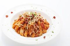 Pastas rojas calientes y picantes de Penne de la salsa Imagen de archivo libre de regalías