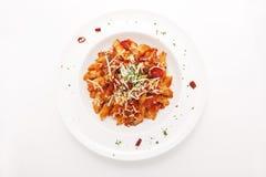 Pastas rojas calientes y picantes de Penne de la salsa Foto de archivo