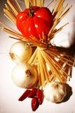 Pastas, tomate y pimientas Imágenes de archivo libres de regalías