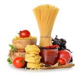 Pastas, tomates y salsa de tomate Fotografía de archivo