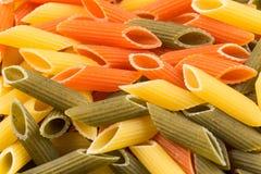Pastas tricolores del penne Fotos de archivo libres de regalías