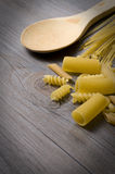 Pastas and Wooden Spoon Royalty Free Stock Photo