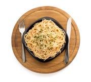 Pastaspagetti på vit bakgrund Fotografering för Bildbyråer