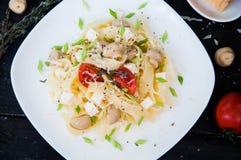 Pastatagliatelle med tomaten Royaltyfri Foto