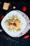 Pastatagliatelle med tomaten Royaltyfria Bilder
