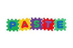 Paste. Word Paste, from letter puzzle, isolated on white background Royalty Free Stock Photo
