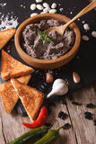 Paste of black beans with ingredients close-up. vertical Stock Image