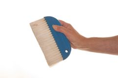 Paste Brush. Hand holding out a clean paste brush Stock Images