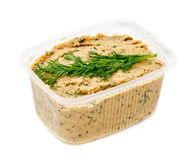 Paste in the plastic container. On the white background Royalty Free Stock Photography