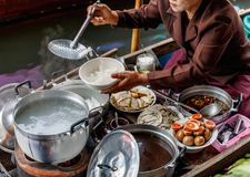 Ratchaburi / Thailand - April 21 2018: Paste of rice flour or boiled Chinese pasta square is the food for breakfast in the boat at royalty free stock photo