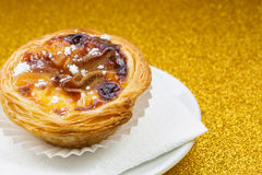Pasteis de Belem, Nata, Portuguese Cake. Golden Background Royalty Free Stock Photography
