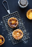 Pasteis de Nata on a Cooling Rack Royalty Free Stock Photography