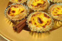 Pasteis de nata - egg tarts on golden plate Royalty Free Stock Photo