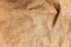Pastel abstract Hessian or sackcloth burlap woven fabric texture background in yellow beige cream sepia brown color. Pastel abstract Hessian or sackcloth burlap royalty free stock photography