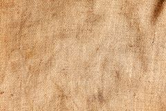 Pastel abstract Hessian or sackcloth burlap woven fabric texture background in yellow beige cream sepia brown color. Pastel abstract Hessian or sackcloth burlap stock photography