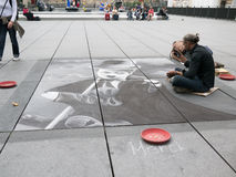 Pastel artist draws Charlie Chaplin on sidewalk in front of Stravinsky Fountain, Beaubourg, Paris Royalty Free Stock Photos