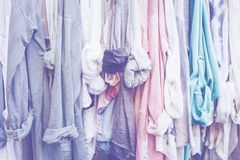 Pastel background with clothes. Pastel background with jersey woman`s clothes in shop royalty free stock image