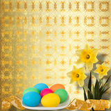 Pastel background with colored eggs and narcissus Royalty Free Stock Photos