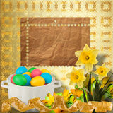 Pastel background with colored eggs and narcissus Royalty Free Stock Photo