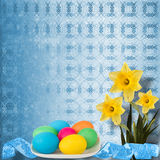 Pastel background with colored eggs and narcissus Royalty Free Stock Images