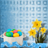 Pastel background with colored eggs and narcissus Stock Photography