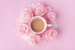Pastel background with morning cup of coffee and beautiful rose flowers. Cozy breakfast for Womens day. Flat lay. Style stock images