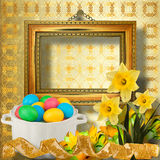 Pastel background with multicolored eggs and narcissus Stock Image