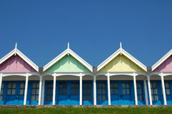 Pastel beach huts. Pastel colored beach huts against a clear blue sky Royalty Free Stock Image