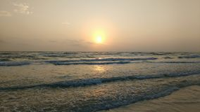 Pastel beach 2. Sunset at Siesta key Beach with fog stock photography