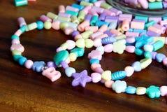 Pastel bead bracelets. The closeup of pastel bead bracelets Royalty Free Stock Photo