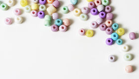 Pastel Beads on White Background. Pastel beads arranged on a white background stock photography