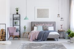 Pastel bedroom with comfortable chair Royalty Free Stock Images