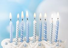 Pastel blue candles. In a row Royalty Free Stock Photos