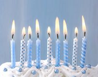 Blue candles in a row. Pastel blue candles in a row Royalty Free Stock Image