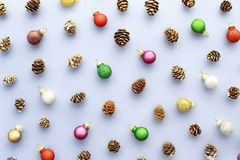 Pastel blue Christmas background with colorful balls and cones. stock images