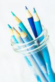 Pastel Blue Colored Pencils In Glass Jar Royalty Free Stock Photography