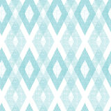 Pastel blue fabric ikat diamond seamless pattern. Vector pastel blue fabric ikat diamond seamless pattern background with hand drawn elements Royalty Free Stock Image