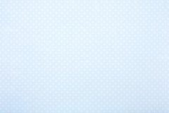 Pastel blue polka dot fabric background for baby Royalty Free Stock Images