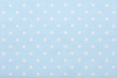 Pastel blue polka dot fabric macro, texture background Royalty Free Stock Photography