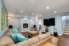 Pastel blue walls in basement living room interior. Stock Photo