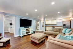 Pastel blue walls in basement living room interior. Royalty Free Stock Photo