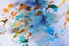 Pastel blue waxy background and brush strokes, hues, spots. Pastel blue abstract background, brush strokes and hand made design with gray, blue, orange, white royalty free stock photography