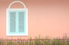 Pastel blue window with white frame on pink wall Stock Photo