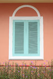 Pastel blue window with white frame on pink wall Royalty Free Stock Images